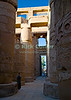 "Luxor, Egypt -- The great hypostyle hall in Karnak Temple.  Karnak was built over many generations of Egyptian pharoah, as each successive king added pieces to this temple honoring the most significant god of the ancient Egyptian pantheon, the god Amun (later, Amon-Ra), the sun god. © Rick Collier / RickCollier.com.<br /> <br /> <br /> <br /> <br /> <br /> travel; vacation; tour; tourism; tourist; destination; Egypt; Luxor; Karnak; ""Karnak Temple""; Amun; Amon; Amon-Ra; temple; hieroglyph; hieroglyphic; ""ancient Egypt""; archeology; archeological; ruin; pylon; wall; column; pillar; ""hypostyle hall"""