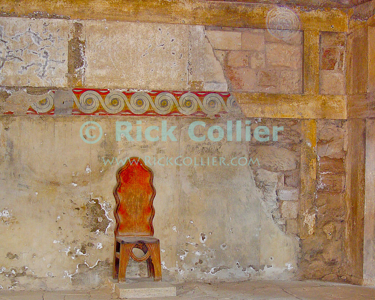 The Palace of Knossos, on Crete, Greece.  Throne room.  The remains of colorful frescoes have been uncovered in the remains of the Palace at Knossos.  This is one of several possible throne rooms that have been uncovered and partially reconstructed.  Probably the ceremonial and political center of the Minoan civilization, the bronze-age palace at Knossos has been partially reconstructed.  © Rick Collier<br /> <br /> <br /> <br /> <br /> <br /> Greece Crete Knossos Minoa Minoan palace fort ruin ruins tourist tourism tourists tour reconstruction history historic archaeology archaeological stair stairways stairs staircase staircases door doors window windows fresco frescoes dolphin dolphins fish bath baths