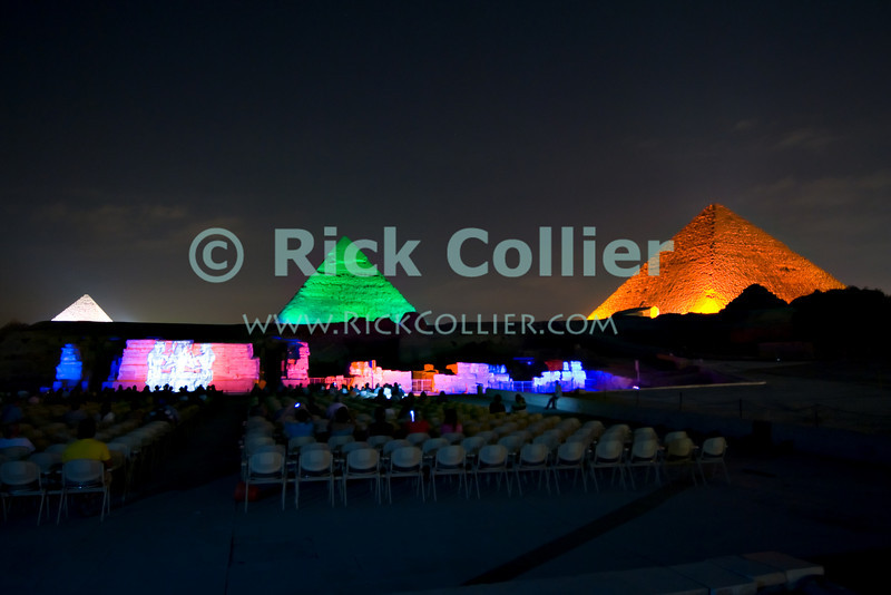 "Giza, Cairo, Egypt -- The three famous pyramids at Giza, surrounded by the ""queen's pyramids"" and with the remains of the funerary temple of Khafre (Khephren) (featuring the Great Sphinx) are spectacularly illuminated during the famous sound and light show at Giza. © Rick Collier / RickCollier.com<br /> <br /> <br /> <br /> <br /> <br /> travel; vacation; destination; Egypt; Cairo; Giza; pyramids; ""Pyramids at Giza""; Cheops; Khufu; Khafre; Kephren; Chephren; Menkaure; Mykerinus; ""Queen's pyramid""; Sphinx; ""Great Pyramid""; ""Great Sphinx""; necropolis; temple; temples; light; night; ""light show""; ""sound and light""; show; presentation"