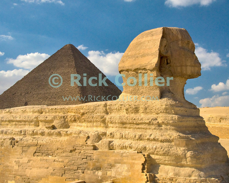 "Giza, Cairo, Egypt -- Viewed from the side, the Great Sphinx, part of the funerary temple of Khafre (Kephren), sits in the foreground with the ""Great Pyramid"" of Khufu (Cheops) in the background. © Rick Collier / RickCollier.com<br /> <br /> <br /> <br /> <br /> <br /> travel; vacation; destination; Egypt; Cairo; Giza; pyramids; pyramid; ""Pyramids at Giza""; tourist; tourism; Khafre; Kephren; sphinx; ""Great Sphinx""; ""Great Pyramid""; Khufu; Cheops"