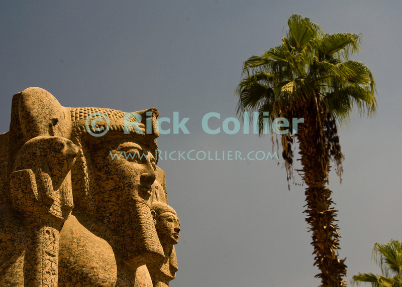 """The Egyptian Museum, Cairo, Egypt -- The famous Egyptian Museum of antiquities in Cairo is flanked outside by ancient statues of long-passed pharoahs. © Rick Collier / RickCollier.com<br /> <br /> <br /> <br /> <br /> <br /> travel; vacation; destination; Egypt; Cairo; antiquities; """"ancient Egypt""""; """"Egyptian Museum""""; statue; stone; pharoah"""