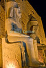 Giant statues (colossi) of Ramses II welcome the visitor to Luxor Temple, Egypt, and are illuminated at night.  Dedicated to the Theban triad of Amun-Min, Mut, and Konsu, Luxor Temple standing in the center of town is lit up at night.  © Rick Collier<br /> <br /> <br /> <br /> <br /> <br /> <br /> Egypt Egyptian Karnak Luxor Amon Amun tourist tourism history historic antiquity antiquities ruins temple tomb pylon wall column pillar ramp ancient 'ancient Egypt' Thebes Theban Thebian Mut Konsu Amun-Min Khonsu obelisk pylon wall Ramses 'Ramses II' statue colossus colossi night illumination lights dark 'after dark' nighttime