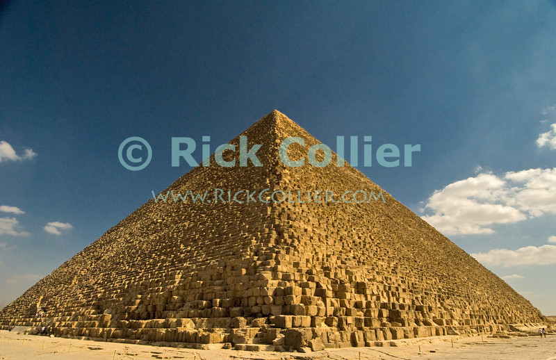 """Giza, Cairo, Egypt -- Viewed from one corner, the Great Pyramid (the pyramid of Khufu, or Cheops) looks like an easily climbed staircase.  Without perspective, it is hard to see that each """"step"""" is about 3-5 feet tall. © Rick Collier / RickCollier.com<br /> <br /> <br /> <br /> <br /> <br /> travel; vacation; destination; Egypt; Cairo; Giza; pyramids; pyramid; """"Pyramids at Giza""""; Cheops; Khufu; """"Great Pyramid"""""""