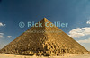 "Giza, Cairo, Egypt -- Viewed from one corner, the Great Pyramid (the pyramid of Khufu, or Cheops) looks like an easily climbed staircase.  Without perspective, it is hard to see that each ""step"" is about 3-5 feet tall. © Rick Collier / RickCollier.com<br /> <br /> <br /> <br /> <br /> <br /> travel; vacation; destination; Egypt; Cairo; Giza; pyramids; pyramid; ""Pyramids at Giza""; Cheops; Khufu; ""Great Pyramid"""