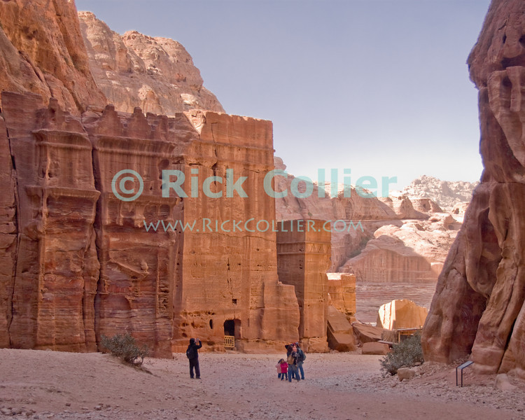 Tombs, Petra -- Tombs look like buildings, carved from the stones lining the valley on the way into the Nabatean town of Petra, Jordan.  © Rick Collier<br /> <br /> <br /> <br /> Jordan Petra Nabatea Nabatean ruin archeology 'ancient world' antiquity cave 'cave dwelling' antiquities Bible Biblical civilization history historic desert stone cliff wall carve carved facade tourist tourism archeology tomb tombs valley block blocks