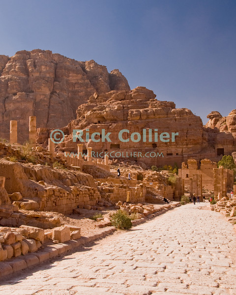 """Petra City Center.  Ruins of the market rim the """"Colonnaded Street"""" (the """"Cardo Maximus"""") built by the Romans on what was originally a Nabatean thoroughfare. © Rick Collier<br /> <br /> <br /> <br /> Jordan Petra Nabatea Nabatean Rome Roman ruin archeology 'ancient world' antiquity cave 'cave dwelling' antiquities Bible Biblical civilization history historic desert stone cliff wall carve carved facade tourist tourism archeology tomb tombs valley block blocks desert necropolis 'colonnaded street' 'Cardo Maximus' arab Bedouin"""