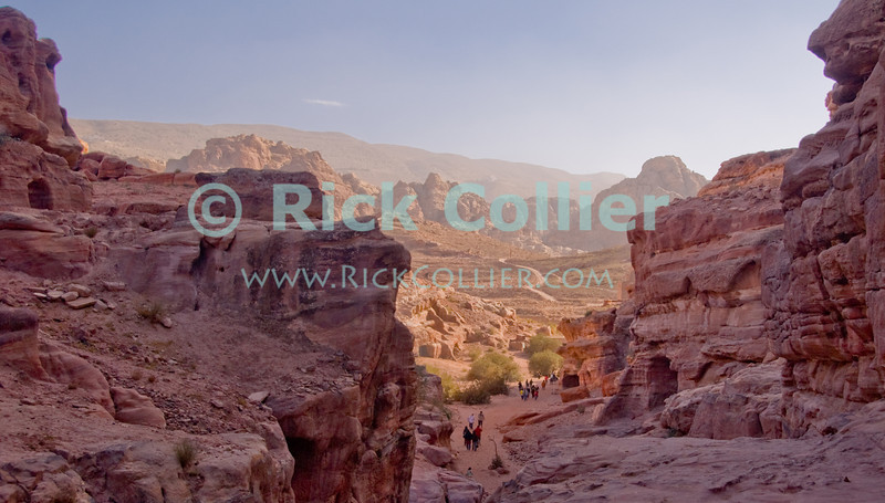 The Petra Valley opens out from the Wadi ad-Deir, at the back of the Nabatean capital city.  © Rick Collier<br /> <br /> <br /> <br /> Jordan Petra Nabatea Nabatean Rome Roman ruin archeology 'ancient world' antiquity cave 'cave dwelling' antiquities Bible Biblical civilization history historic desert stone cliff wall carve carved facade tourist tourism archeology tomb tombs valley path road hike trail desert necropolis 'Wadi ad-Deir'