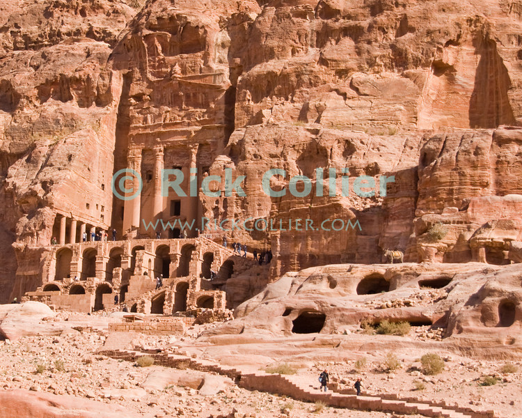 The Urn Tomb was carved from the rock cliff, at the edge of the valley that housed the capital of Nabatea.  Petra, Jordan.  © Rick Collier<br /> <br /> <br /> <br /> Jordan Petra Nabatea Nabatean ruin archeology 'ancient world' antiquity cave 'cave dwelling' antiquities Bible Biblical civilization history historic desert stone cliff wall carve carved stone rock valley facade tourist tourism archeology tomb tombs valley block blocks desert necropolis 'Urn Tomb'
