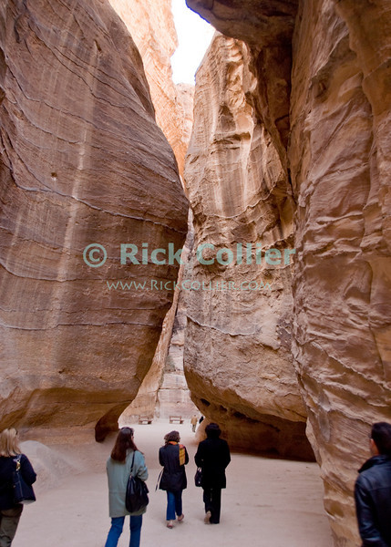 The Siq -- The path into the Nabatean capital at Petra, Jordan, passes for about 1.2 km through this natural stone valley.  Note that this is not a canyon carved by water, but a divide created by tectonic forces.  Note the matching rock grain on both sides of the path.  © Rick Collier<br /> <br /> <br /> <br /> Jordan Petra Nabatea Nabatean ruin archeology 'ancient world' antiquity cave 'cave dwelling' antiquities Bible Biblical civilization history historic desert Siq 'river bed' carving tectonic walk stone cliff wall