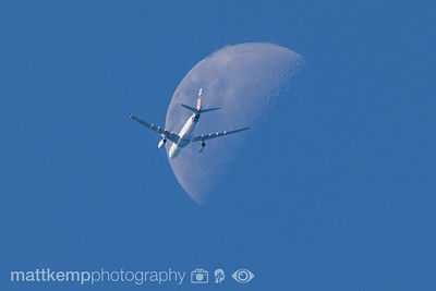 sigma lens plane and moon