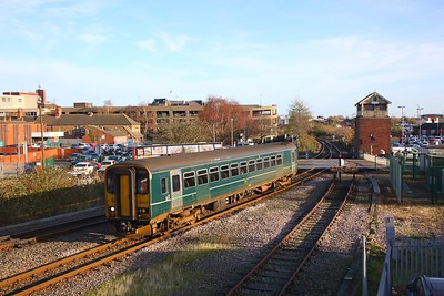 153377 on the 2F87 1055 Cleethorpes to Barton on Humber arriving at Grimsby Town and passing Garden Street signal box on the 30th November 2018