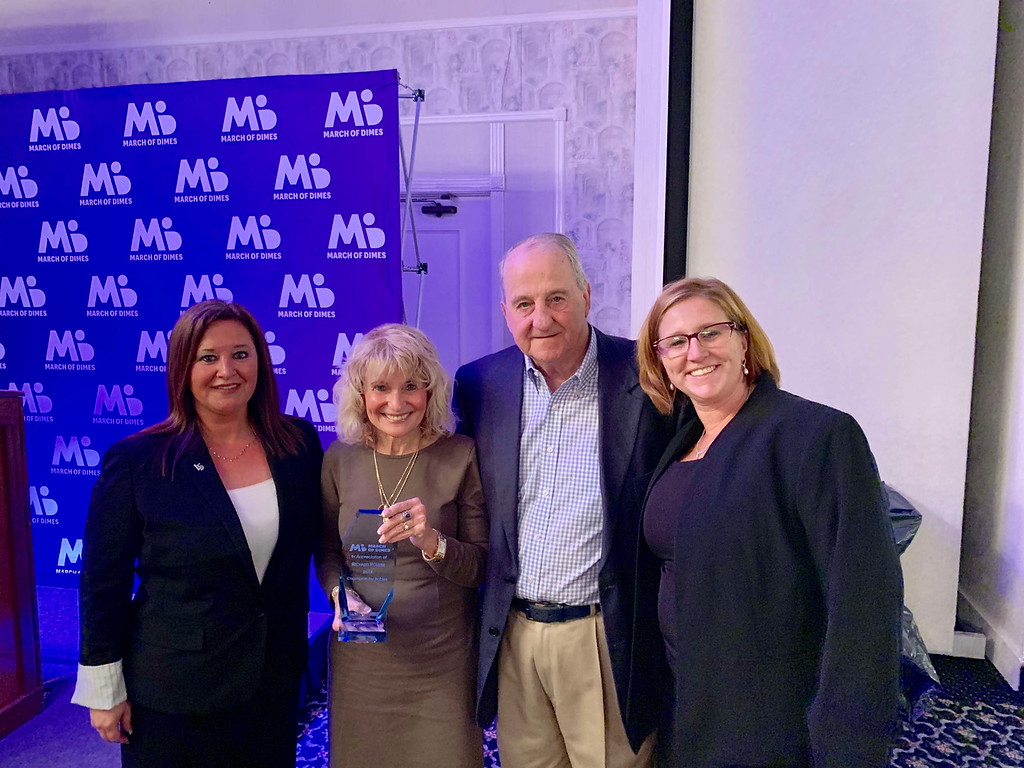 . From left, co-Chair Jenna Guilbeault of Lowell, Cathy Rourke of Lowell, Ricardo�s wife, holding the plaque dedicated to her late husband, Jack Rourke, Ricardo�s brother, of Chelmsford, and Janel Dolan of Nashua