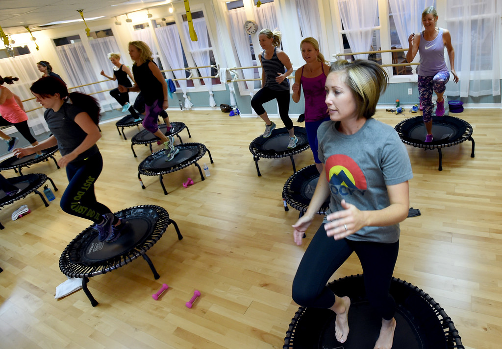 . Julie Taylor, right, joins in on the signature class on Thursday. Julia Franklin\'s Signature Class at Begin Fitness in Niwot. For more photos and a video, go to dailycamera.com.  Cliff Grassmick  Staff Photographer October 5, 2017