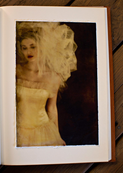 Veiled, Tissue Print bathed in Bees Wax, mounted on the album page.