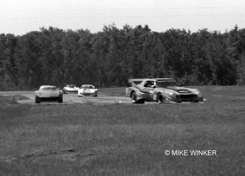 # 4 - 1978 IMSA - Rusty Schmidt on left at Brainerd chasing # 21 Carl Shafer Camaro widebody