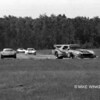 # 4 - 1978 IMSA - Rusty Schmidt on left at Brainerd chasing # 21 Carl Shafer Camaro widebody