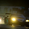 Corvette Racing, 24 Hours of Le Mans, June 13-14, 2009, C6.R #64, driven by Oliver Gavin, Olivier Beretta, and Marcel Fassler, going through Indianapolis Corner ahead of a prototype during Wednesday's rain-soaked practice (photo credit Richard Prince/GM Racing).