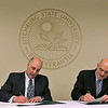 """Fitchburg State University President Richard Lapidus  and Executive Director of Municipal Police Training Committee Dan Zivkovich sign the articulation agreement between the university and the state's Municipal Police Training Committee for our """"4+1"""" police concentration program, wherein students can complete their bachelor's and master's degrees as well as full certification to serve in any municipal police department in the state at the college on Tuesday afternoon. SENTINEL & ENTERPRISE/JOHN LOVE"""