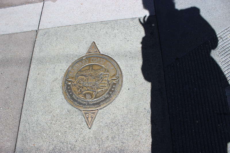 Sidewalk Medallion and Shadow