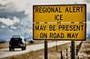 Highway road sign ice alert winter storm car truck danger