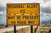 Highway road sign ice alert winter storm car truck dangerous