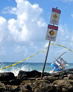 Warning Signs and Capsized Boat