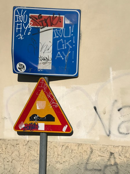 Street Sign with Grafitti in Trieste, Italy