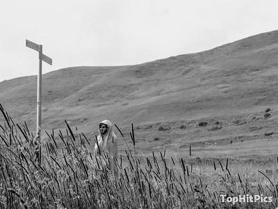 """Boy Holding A """"Poderale Rifugio"""" Sign In Vetan, Aosta Valley, Italy"""