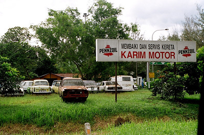 Not a very confidence-inspiring 'Motor repair and service' shop in Perak, Malaysia