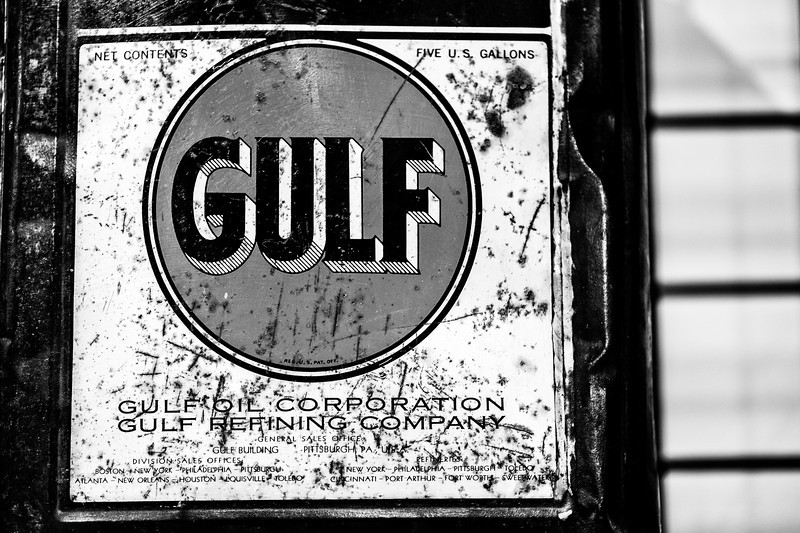 vintage Gulf Oil sign on a five gallon container