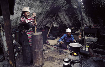 Making yak butter in a tent on the Lhonak plateau