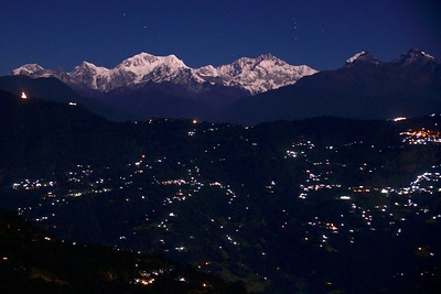 Kangchenjunga range from Rinchinpong/Kaluk on a full moon night - the lights in the  front are Gayzing, middle Gayzing , Pelling and Pemayangtse