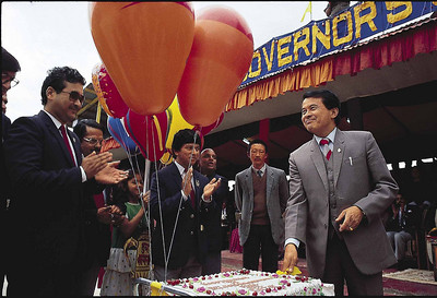 Nar Bahadur Bhandari cuts his birthday cake at the Paljor Stadium Gangtok