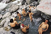 A family bathes at the hot springs of Borong, South Sikkim