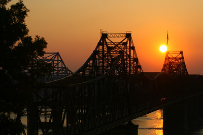 A beautiful delta sunrise or sunset! Southern transportation comes in all forms. From tractors to mules, from trains to boats!