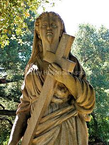 Alta Mesa Memorial Park statue of a woman carrying a cross