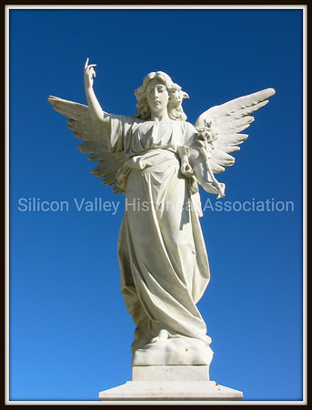Angel pointing towards the heavens at the Italian Cemetery in Colma, California