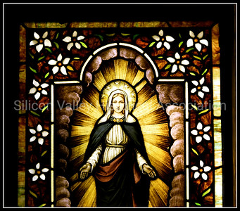 Stained glass window of the Blessed Virgin Mary with a Halo of Stars