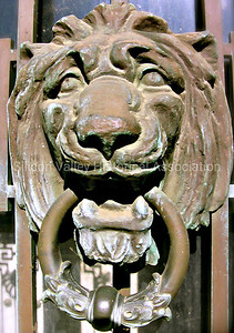 Lion's head door knocker on a crypt at the Oak Hill Memorial Park in San Jose, California