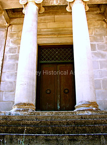 Large wooden doors leading into a family crypt at St. John's Cemetery in San Mateo, California