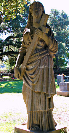 Alta Mesa Memorial Park statue of a woman carrying a cross