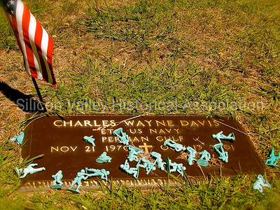 Military grave with toy soldiers at St. John's Cemetery in San Mateo, California