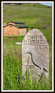 Wooden grave marker for Chris Dutsch (1939-1999) at St. Anthony's Cemetery