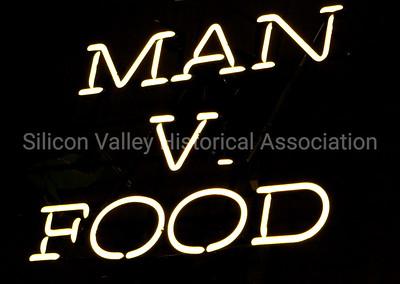 Man vs. Food neon signage at Henry's Hi-Life Restaurant in San Jose, California