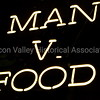Man vs. Food neon signage at Henry's Hi-Life Restaurant in San Jose, California