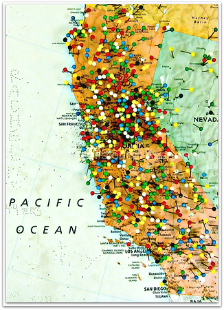 California map with colorful stick pins
