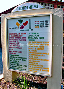 Cupertino Village shopping center signage in English