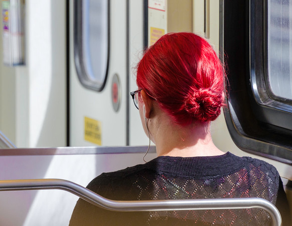 A red haired lady on VTA in San Jose