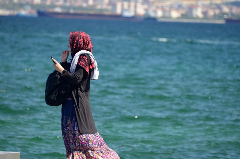 A lady with cell phone at San Francisco Embarcadero