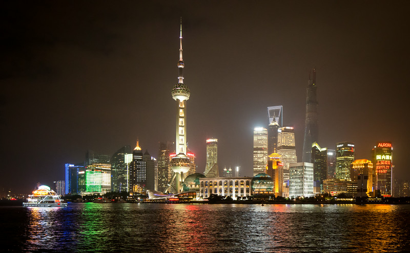 Shanghai, China: looking across the Huangpu River at brilliantly lit Pudong.
